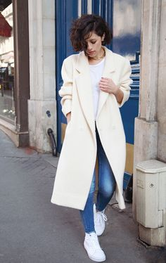 White tee shirt, skinny jeans, high top tennies and a beautiful white wool coat.  Oh, so casual, yet chic. KARLAS CLOSET in Paris.