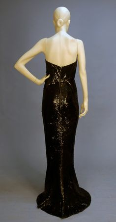 """Balmain couture evening sequin mermaid gown 1950's. Black sheath with sweetheart bodice having boned and wired cotton corset, cotton net gown covered in black sequins with flared hem, silk lining, back zipper. Label """"Pierre Balmain Paris"""" with tape inked 59749."""