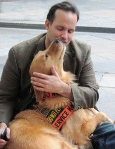 """Former U.S.Army Captain Luis Carlos Montalvan and his service dog """"Tuesday""""."""