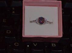 LOOK!!!!!!!!!!! A STUNNING STERLING SILVER BLACK FIRE OPAL AND AAAAA CZ RING SIZE 5
