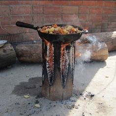 You can start a Swedish fire log to cook a rustic, outdoor meal in a cast iron skillet, or pop on your potjie pot.
