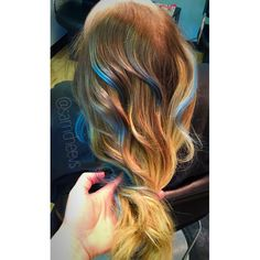 Natural blonde ombré hair .. Blue / teal / light blue high lights .. Styled using marula oil products and a curling wand