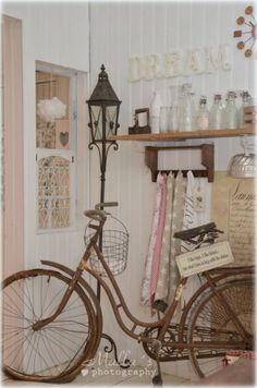 Clever use of bike storage although I don't think that's the case for this bike. Fits right in with the décor. Do you think the bike may have been part of her childhood? Shabby Chic Shops, Shabby Chic Cottage, Vintage Shabby Chic, Shabby Chic Style, Shabby Chic Decor, Devine Design, French Country Cottage, Romantic Homes, Rustic Charm
