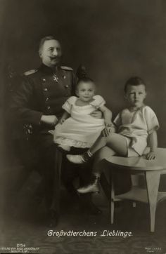 A cute composite of Kaiser Wilhelm II with grandsons, prince Louis Ferdinand in his laps and Prince Wilhelm.