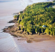 This beautiful aerial view of the Bay of Fundy shows the unspoiled nature you can discover in this amazing part of the world Hopewell Rocks, Atlantic Canada, Newfoundland And Labrador, New Brunswick, Whale Watching, Canada Travel, Aerial View, Kayaking, Scenery