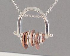 Silver, copper and brass pendant