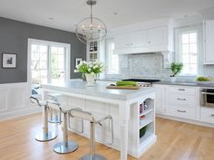 """Kitchen. The hardware for this kitchen is from Belwith. Stools are from """"Design Within Reach"""" and floors are natural maple hardwood. #kitchen"""