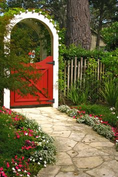 Little Red Door Unleash some barnyard style into your garden with a small red door beneath a crisp white vine-covered arch, a combination that shows just how sophisticated country style can be.  See more at Tales From Carmel.  Courtesy of Tales From Carmel