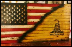 """Display some American spirit in your home with this rustic """"Don't Tread On Me"""" American flag sign. The Gadsden flag is steeped in American patriotism that helpe Old American Flag, Rustic Wooden American Flag, Wooden Flag, Infinity Symbol Love, Gadsden Flag, Making Signs On Wood, Reclaimed Wood Signs, Flag Signs, Checkered Flag"""
