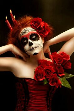 Day of the dead/Dia de los Muertossugar skull make-up - notice the flowers in her hair and dress for the extra special touch...