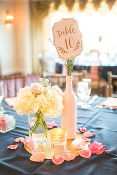 My DIY Centerpieces!! Gold spray painted record | Ballet pink spray painted wine bottles | Gold paint/glitter dipped mason jar with sand and candle | Gold and blush table numbers from Michael's | Flowers and vase from Florist