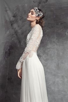 Cut out French lace open back bodice, hand decorated with seed beads, #Swarovski crystals and pearls. Reinterpreted long sleeves. Gathered silk skirt with train.