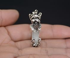 This ring is made in the shape of a yorkshire terrier that wraps around your finger. They are one size fits all and are plated in silver, bronze and black. This is perfect for anyone looking for uniqu