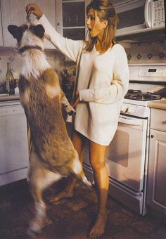 Well this is just perfect: 90's Jennifer Aniston, a shirt dress, and a giant, jumping dog | the berry