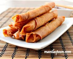 """Lumpiang Shanghai or Filipino Spring Rolls are traditionally made of ground meat (usually pork), minced onions, finely chopped carrots and seasoning all rolled up in a paper thin wrapper made with flour and water. It is sealed at the end either by using a sticky beaten egg or plain water. By the name it is given, you can almost guess that it has its origins in China though for some reason we haven't dropped the """"Shanghai"""" at the end and continues to use it to this day. I suppose the reason…"""