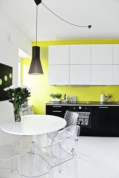 Modern kitchen in black, white and chartreuse.