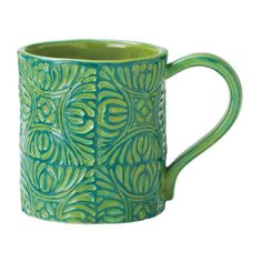 Savor fresh coffee, loose-leaf tea, and homemade vegetable soup in this charming mug from Magenta, boasting a brightly hued tile motif on a classic silhouett...