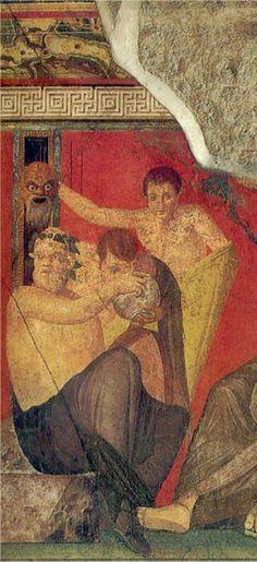 Dal rituale dionisiaco dell'affresco nella Villa dei misteri di Pompei: all'iniziato viene offerta la coppa cerimoniale di Dioniso nella quale vedrà riflessa la maschera di Dioniso tenuta sollevata sopra le sue spalle. Un'infusione simbolica della bevanda con lo spirito del dio che puo' essere paragonata alla cerimonia cattolica dell'elevazione del calice durante la messa.