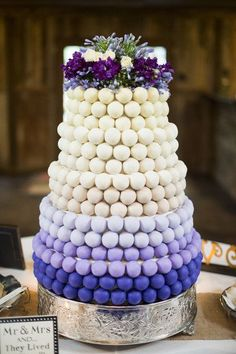 A three tiered purple an white ombre wedding cake made ENTIRELY of cake pops!