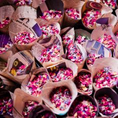 I love the confetti cone idea! so cheap and easy! A rustic wedding with LOTS of budget DIY details, including these confetti cones made out of pink newspaper & filled with dried flowers!