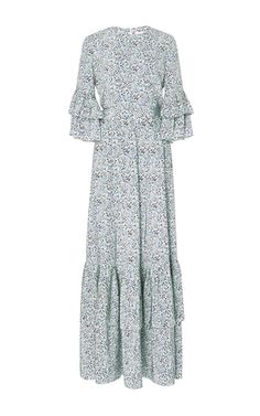 This **Co** Printed Maxi Dress With Tiered Hem features a high round neckline, cropped sleeves with tiered ruffle design, and a floor length hem.