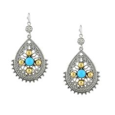 A fashionable set of earrings featuring Moroccan-style filigree drops with gold-toned and turquoise-colored accents. Round, silver-toned filigree spheres dangle at the posts for an added charm.