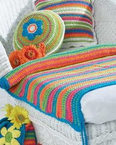 Bring some excitement with you to the beach this summer with this Beginner Beach Mat. The bright stripes will definitely add a pop of color to your fun in the sun. It's an easy crochet pattern to complete that's perfect for any beginning crocheter.
