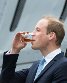 Prince William, Duke of Cambridge enjoys drink after making a toast during an official visit to The Royal Navy Submarine Museum, 12.05.14 in Gosport, England.