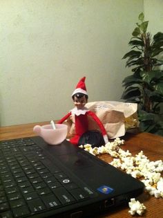 Popcorn and movie night on the laptop.