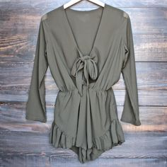 - Lightweight polyester material - Long sleeved playsuit as seen on rocky barnes - Low cut neck - Tie up front - Elastic waist - Frilled bottoms - imported - by Lioness