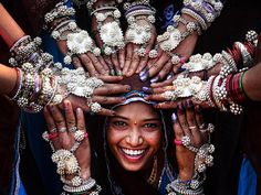 "© Sanghamitra Sarkar, India, Entry, Open, Smile, 2016 Sony World Photography Awards ""Tribal women of Gujrat in India wearing traditional silver ornaments and blessing a newly married girl."""