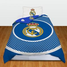 Real Madrid bedding. Ideal for the bedroom of any fan. Sizes (all approx): Single - Duvet Cover: 135cm x 200cm, Pillow Case (x1): 50m x 75cm. Double - Duvet Cover: 200cm x 200cm, Pillow Case (x2): 50cm x 75cm. 52% Polyester 48% Cotton. Machine Washable.