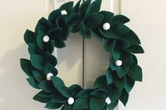 Easy DIY felt holly wreath by Sarah Gunn at Canadian Living.  I thought  the way she covered the styrofoam wreath prior to pinning the leaves on was interesting.  Instead of wrapping felt around and around, she cut strips of felt to cover the inner and outer edges, and flat front side of the wreath separately.