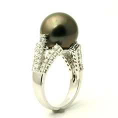 Tahitian Cultured Black Pearl Engagement Ring - A unique piece that leans more toward the darker side comes this beautiful Tahitian Cultured Black Pearl Engagement Ring stamped in 18k White Gold featuring a Dark Purple colored Tahitian Cultured Pearl set on the top of the ring surrounded by White Round accent side stones on the ends of the finger style shank. This Black Pearl ring is 13.2mm in diameter & the total gem weight is equal to .97 carats. #unusualengagementrings