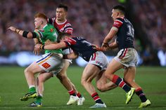 Corey Horsburgh of the Raiders is tackled by Joseph Manu of the Roosters during the 2019 NRL Grand Final match between the Canberra Raiders and the Sydney Roosters at ANZ Stadium on October 2019 in Sydney, Australia. Rugby League, Roosters, Sydney Australia, Raiders, Joseph, October, Running, Game, People