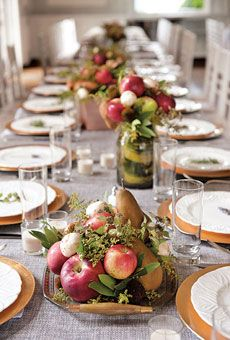 Centerpiece of locally grown apples, pears, peaches, and mushrooms accented with sprigs of mint, bay leaves, echinacea, and moss, displayed on vintage trays. Arrangement by Datura: A Modern Garden, Middletown, CT. Photo by Carla Ten Eyck Photography