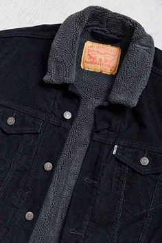 Levis Black Corduroy Sherpa Trucker Jacket - Urban Outfitters, owned one of these in the wrong size with a white collar and didn't like it because of the white collar and lining. with the Grey lining and in medium Im sure I will like it more to go with my other 3 Levis Truckers I have collected over many years.