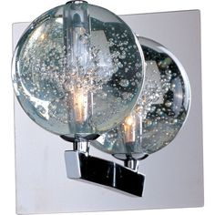 Add a dramatic luster to your room with this clear bubble glass Orb wall sconce. The mesmerizing light imitates the flowing movements of water and air as it shines through the glass and reflects off the polished chrome frame.