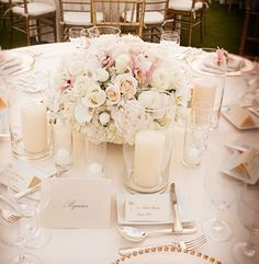 Love how they've made the perfect combination of flower arrangement & candle lights