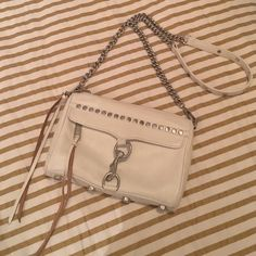 Rebecca Minkoff Studded Crossbody This is in excellent condition! I'll be sure to completely wipe down before sending! It's super cute and goes with everything! I recently got a new Crossbody so I don't wear this one anymore! Rebecca Minkoff Bags Crossbody Bags