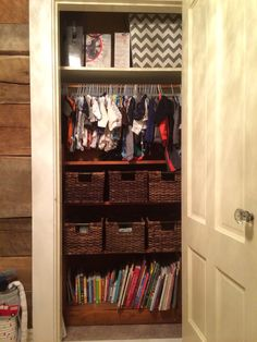 Nursery closet organization...love how I used the space. I also covered the inside closet old wallpaper with gray white and yellow chevron fabric.