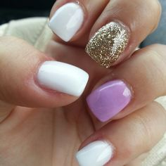 white orchid and gold glitter nail design