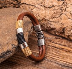 Double strand leather bracelets in black and chestnut brown. This bracelet style features a double strand of 5mm leather round cord, hemp, and a strong- secure metal buckle clasp for easy on and off. These are Made To Order to your wrist size. See Tips Below: Materials: Lead and
