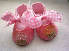 Pink shoes with cupcakes for baby girl.