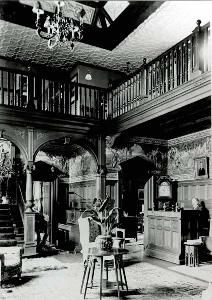 The hall of Bromham House in 1903 with W.H.Allen playing the organ [Z50/21/27]