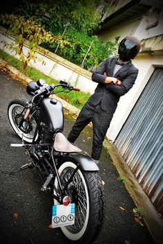 This motorcycle is awesome. The guy should pick up his pants though