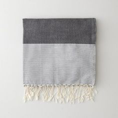 "Traditional towels from Tunisia are hand woven on looms using natural cotton which will become more absorbent and softer after washes. Thin stripe pattern weave with twisted tassel ends.      • high absorbency  • dimensions: 78"" x 38""  • 100% natural cotton"