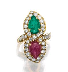 RUBY, EMERALD AND DIAMOND RING, BULGARI, 1980S.  Set with a pear-shaped cabochon star ruby and a similarly shaped emerald, framed within a figure eight of brilliant-cut diamonds, signed Bulgari