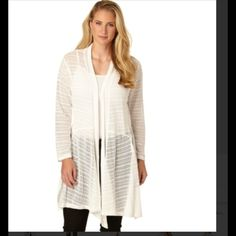 High Low Open Cardigan Jessica Simpson open white cardigan with a lacy look. Lightweight and has high low design. Made from 98% polyester, 2% elastane. Color is Cloud Dancer. Jessica Simpson Sweaters Cardigans