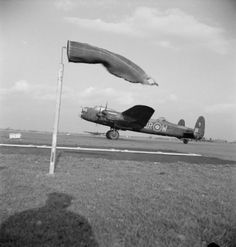 Avro Lancaster B Mark I, DV397 'QR-W', of No. 61 Squadron RAF taxying past the windsock at Coningsby, Lincolnshire. DV398 was lost during a raid on Berlin, Germany on 24/25 March 1944.